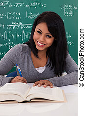 Portrait Of Female Student Studying