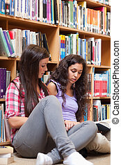 Portrait of female students reading a book
