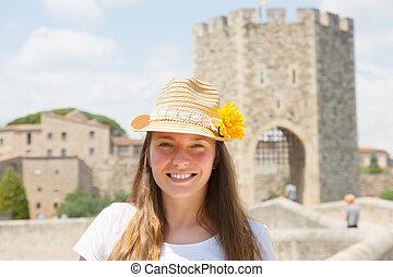 tourist with Medieval bridge in background. Besalu - ...