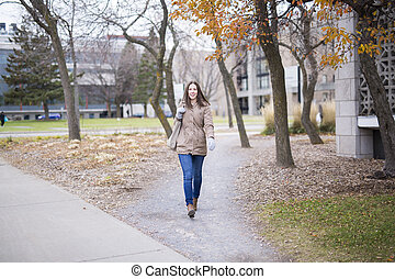 Portrait Of Female University Student Outdoors On Campus