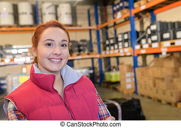 portrait of female worker in warehouse