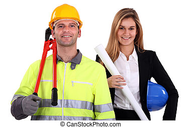 portrait of fine-looking female architect and workman