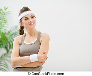 Portrait of fitness woman looking on copy space