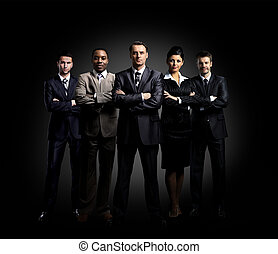 Portrait of five businesspeople standing