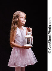 Portrait of five year old girl with a candlestick