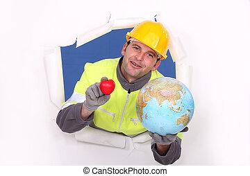 portrait of foreman holding globe
