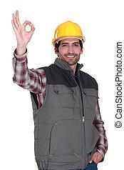 portrait of foreman making okay sign