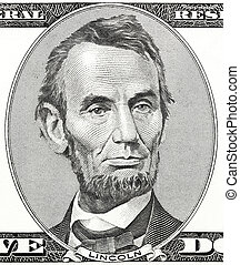 Portrait of former U.S. president Abraham Lincoln as he looks on five dollar bill obverse