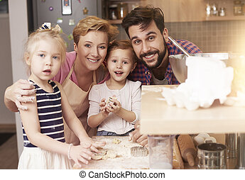 Portrait of four people family in the kitchen