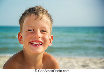 Portrait of four years boy on beach