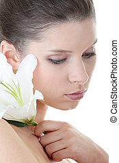Portrait of Fresh and Beautiful woman with flower