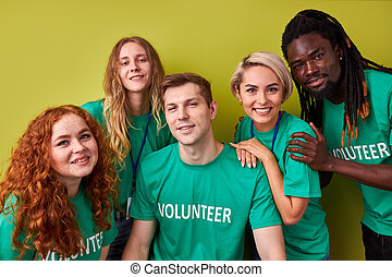 portrait of friendly charity team volunteering together