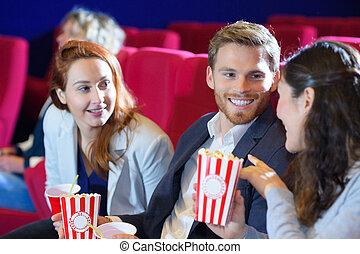 portrait of friends in the cinema