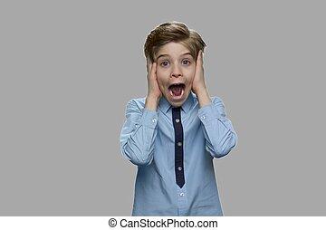 Portrait of frightened child boy.