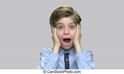 Portrait of frightened child boy. Shocked scared little boy...