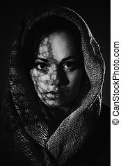 Portrait of front view beautiful woman face with a black scarf. Monochrome photo, art noise