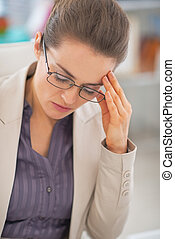 Portrait of frustrated business woman with eyeglasses in...