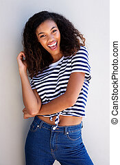 fun young african american woman laughing against white background