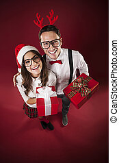 Portrait of funny couple with christmas present