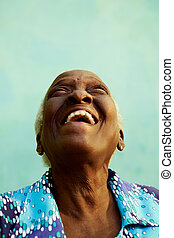Old people and emotions, portrait of bizarre senior african american lady laughing with head tilted up. Copy space