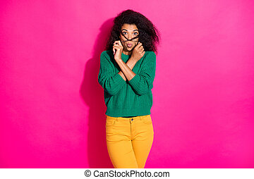 Portrait of funny funky afro american girl have fun free time on winter fooling holding hairdo wear stylish jumper pants isolated over bright color background