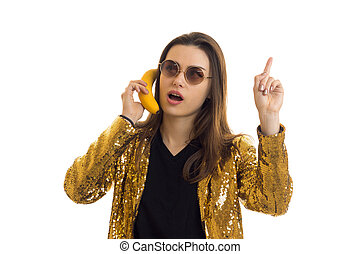 Portrait of funny glamorous girl in glasses and a banana in her hand