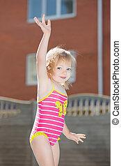 Portrait of funny little blond girl