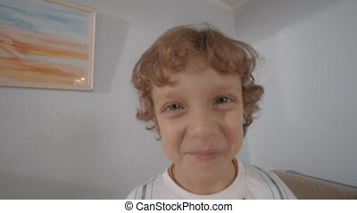 Portrait of funny little boy with curly hair - Slow motion...