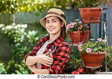 gardener girl with secateurs