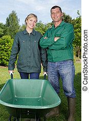 portrait of gardening team with wheelbarrow