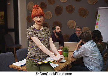 Portrait of ginger woman during the office