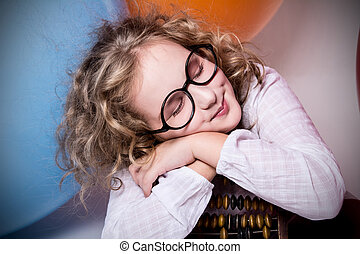 Portrait of girl dreaming in glasses with eyes closed again