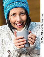 Portrait of girl drinking tea
