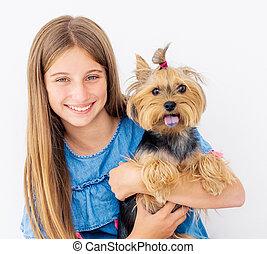 Portrait of girl holding dog