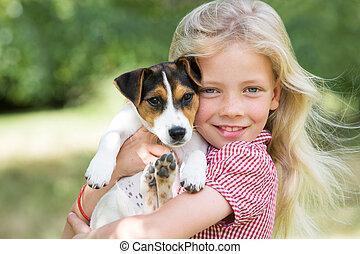Portrait Of Girl Holding Pet Dog