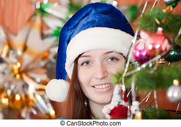 girl in blue Christmas hat
