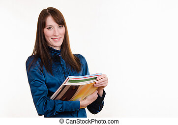 Portrait of girl in office clothes and with magazines