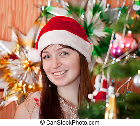 girl in red Christmas hat
