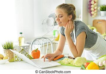 Portrait of girl in the kitchen prepares