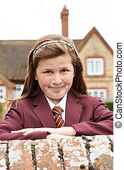 Portrait Of Girl In Uniform Outside School Building