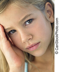 Portrait Of Girl Looking Sad