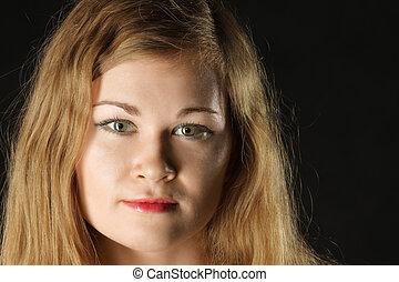 Portrait of girl over dark background