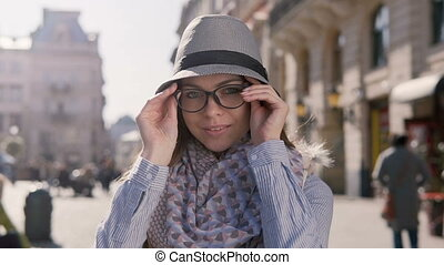Portrait of Girl Putting on Glasses