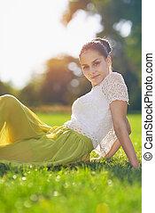 Portrait of girl sitting on meadow