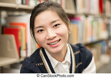 Portrait of girl smiling in library