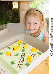 portrait of girl with a cake