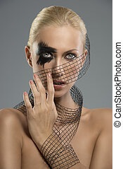 portrait of girl with creative make-up with hand near the face