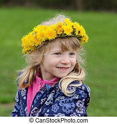 portrait of girl with dandelions in head