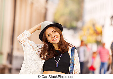 Portrait of girl with hat on the street during