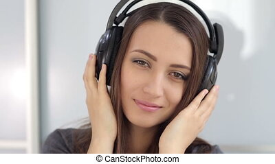 attractive girl with headphones listening to music